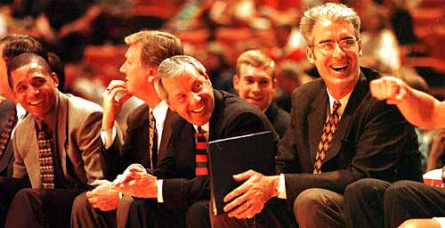 New North Carolina coach Matt Doherty, far right, shared a laugh with KU coach Roy Williams, plus fellow KU assistants Neil Dougherty, left, and Joe Holladay, second from left, during the 1998-99 season, Doherty's final season at KU.
