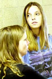 Rose Anna Erhart, left, and Bledsoe's estranged wife, Heidi Bledsoe, ponder the sentence.