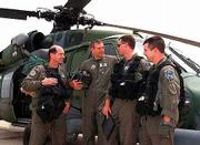 Air National Guardsmen, from left, Lt. Col. Dave Ruvola, co-pilot; Chief Master Sergeant Alan Manuel; Lt. Col. Mike Canders, pilot; and Master Sergeant Bill Cunningham, flight engineer, stand in front of their HH-60 Pave Hawk Helicopter in Westhampton Beach, N.Y. For years, the members of the 106th Rescue Wing have done their work with little recognition, but now they are stars. The new film The Perfect Storm recounts their exploits.
