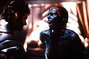 "Wolverine, played by Hugh Jackman, left, and Mystique, played by Rebecca Romijn-Stamos, square off in a deadly duel in this scene from ""X-men."" The movie, which is based on a comic book series, opened this weekend in theaters across the country."