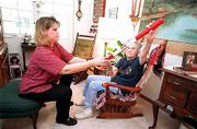 Kim Hoffman, co-owner of Lawrence Therapy Services, helps Ethelyn Falwell build arm strength with a therapy bar in Falwells apartment. You get to see people in their home environment, Hoffman said. If you see them in a clinic, you dont know what happens to them when they get home.