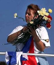 A Cuban exile prepares to throw flowers into the sea during a memorial service Saturday off the coast of Cuba.