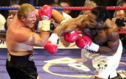 Lennox Lewis, right, swings at Francois Botha during their heavyweight fight Saturday in London.
