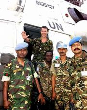 British Maj. Andy Harrison steps out of a U.N. helicopter Saturday in Freetown, Sierra Leone. Harrison and other U.N. military observers were rescued after being trapped by rebels in a U.N. base in the east of the country.