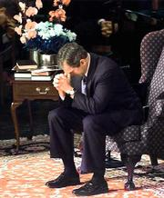 Texas Gov. George W. Bush bows his head in prayer before speaking during a service in March at the Second Baptist Church in Houston.