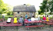 During a religious service at Clinton Lake, vacationers sit at the Smokehouse Amphitheater. The services, coordinated by Clinton Lake Ministries, are a way for people vacationing at the lake to fill their spiritual needs.