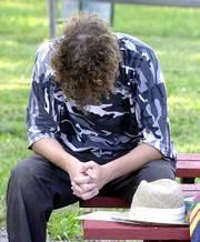Brandon Smith of Tonganoxie prays during a church service at Clinton Lake.