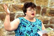 Pastor Debby Dick sings the opening hymn during a religious service at Clinton Lake. The service is coordinated by Clinton Lake Ministries, a group of United Methodist churches in the region.