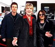 The Goo Goo Dolls Johnny Rzeznik, center, spends a busy day with U.S. Sen. Ted Kennedy during Choose or Lose: Why Care, which airs at 9 p.m. Sunday on MTV.