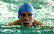 Lawrences Ralph King, 69, swims the 100 breaststroke during the Sunflower State Games on Saturday at Robinson Natatorium.