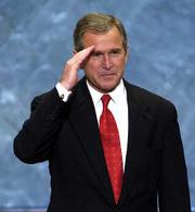 George W. Bush salutes Thursday at the Republican National Convention in the First Union Center in Philadelphia. Bush accepted the GOP party nomination for the presidency.