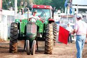 Wes Flory, Baldwin, won the tractor pull in 3000-pound class by pulling a sled 271.2 feet with his Oliver tractor Thursday night at the Douglas County Fair.