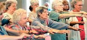 Members of the Northern California Osteoporosis Association Support Group practice tai chi at their monthly meeting in Redding, Calif.