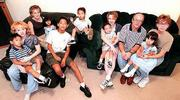 Larry and Brenda Compton, at right, have adopted six foreign children with a seventh on the way to add to their three daughters by birth. From left are Dimitri, 5; Courtney, 22; Bethany, 19; Taryn, 2; Evan, 11; Kenyan, 3; Rider, 2; Adrian, 24; Larry; Tia, 3; and Brenda.