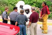 A hazardous waste scare at the Sallie Mae loan servicing center has Lawrence-Douglas County Fire & Medical personnel donning protective clothing. The Fire & Medical employees were receiving instructions from Lawrence police before entering the loan servicing center, where an envelope was thought to contain a toxic substance.
