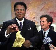 Muhammad Ali performs a magic trick as actor Michael J. Fox looks on during a party given by George Magazine and the Creative Coalition to benefit the Michael J. Fox Foundation for Parkinson's Research. Both Ali and Fox have Parkinson's disease. Kansas University Professor Janet Hamburg has created a new movement program that can help some people with Parkinson's regain lost mobility.
