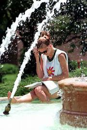 Enjoying the Chi Omega Fountain in this 1997 file photo is Charity Alloway of Conway Springs.