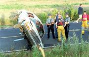 Emergency personnel work the scene of a rollover accident on U.S. Highway 40 west of Lawrence. A Topeka woman, 52-year-old Joyce Tavernaro, was air-lifted to Kansas University Medical Center, and 36-year-old Dana J. Trogeson, Tecumseh, was taken to a Topeka hospital for treatment.