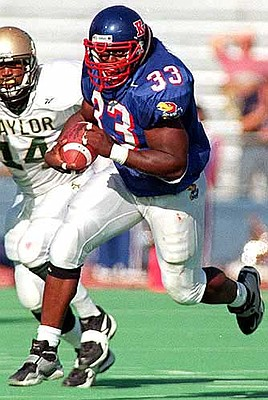 Kansas' football team is counting on the 1-2 punch of fullback Moran Norris (33) and tailback David Winbush (22). Moran Norris is shown above.