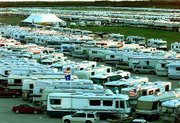 Sales of recreational vehicles are surging to record levels. Last month in Maine, about 6,000 RVs jammed the runways of a naval air station for the 37th Family Motor Coach Assn. convention.