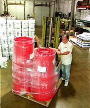 Pur-O-Zone, a Lawrence-based manufacturer and distributor of cleaning chemicals and supplies, will start shipping products like these next month to Boeing Co. in Wichita. That's when Bob Darby, Pur-O-Zone's production manager, figures to have plenty more work to do at the company's Lawrence center, 345 N. Iowa Street.