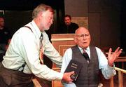"Robert Matthews, portraying Henry Drummond, left, questions Fred Bahr (Brady) during a rehearsal for ""Inherit the Wind."""