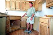Lawrence home builder Ron Durflinger is taking a new approach with housing construction. He's starting to add features that appeal to both an aging population and people with disabilities. In a house being built on Harvard Road, the kitchen features lowered cabinets and a sink that can be adapted to wheelchair use. Some cabinets also have pull-out shelves for easy access.