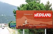 A sign draws attention to the holiday resort Heidiland, in the region Sarganserland-Walensee in Switzerland. Heidiland is an unexpected treasure of Alpine foothills and peaks, deep lakes and lovely villages.