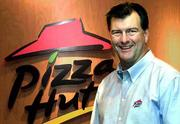 Michael Rawlings, a former advertising executive, was brought in as Pizza Hut's president in 1997. Executives at Pizza Hut and its new parent, Tricon Global Restaurants Inc., began repairing the Dallas-based chain's image by closing some restaurants and spending $125 million to renovate 120 more part of a $1 billion facelift during the next five to seven years.
