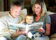 "Enjoying story time with their son Miles, 2, Dan and Jill Blomgren read ""Where the Wild Things Are"" aloud. Miles, who has a rare liver disease, is awaiting a liver transplant."