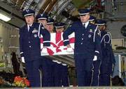 A U.S. Air Force honor guard carries a sailor's coffin from a C-17 Air Force aircraft at the U.S. air base in Ramstein, Germany. The United States says 17 sailors died and 33 were injured in the explosion on the USS Cole while it was refueling Thursday in the Yemeni port of Aden. Seven bodies have so far been recovered. The blast tore a hole 30 feet high and 40 feet wide at the ship's waterline. U.S. officials say suicide bombers blew up a small boat next to the destroyer. The photos of 16 victims also are shown. A picture of the 17th, Gary Swenchonis, was not available.