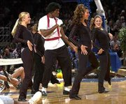 KU senior Kenny Gregory, dressed as Michael Jackson, dances with the Crimson Girls during Late Night With Roy Williams in this October 2000 file photo. The Jayhawks kicked off their season with the annual event Friday night at Allen Fieldhouse.