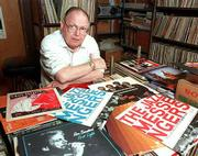 Dick Wright, Kansas University associate professor of music and dance, sits among some of the hundreds of records and tapes in his collection of jazz music. Wright died of cancer last year and a memorial concert is being held in his memory. The concert is set for Sunday in the Topeka Performing Arts Center.