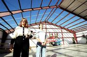 Dance City Performing Arts Academy will open its $1 million, 10,000 square-foot building in early January. Owners Judi Mahaley, left, and her daughter, Lori Tochtrop, survey the facility's progress Wednesday afternoon. The roof is nearly complete. The new building is at 5150 Clinton Parkway, just east of Sport 2 Sport.
