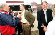 Kansas Republican Party leaders are campaigning for party candidates around the state on their Kansas Victory Tour 2000. On Wednesday, the tour kicked off in Ottawa. There, Ottawa resident Bruce Osladil, left, talks politics with Secretary of State Ron Thornburgh, second from left, while House Majority Leader Kent Glasscock, second from right, visits with Juanita Zeek, Franklin County treasurer. The tour continues through Friday, when it ends at the Statehouse.