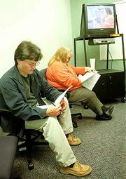 Mike Schneider, left, and Penny Lentfer, both of Topeka, fill out applications for customer service jobs at Sprint PCS's Lawrence Customer Care Center in the Lawrence Riverfront Plaza. The nationwide unemployment rate is at its lowest level in 30 years.