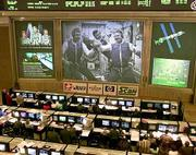 Operators of Russia's Mission Control center monitor the crew floating inside Expedition One floating space station, at Korolyov, just outside Moscow. The central screen Thursday showed American astronaut Bill Shepherd, right, Russian cosmonauts Yuri Gidzenko, center, and Sergei Krikalev, left.