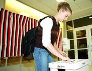 The day before the real thing, eighth-grader Ashley Jackson drops her ballot in the collection box during a mock election at Southwest Junior High. Southwest students and staff participated in the mock election Monday, tapping Texas Gov. George W. Bush of Texas as president. Polling sites are open from 7 a.m. to 7 p.m. today for elections.