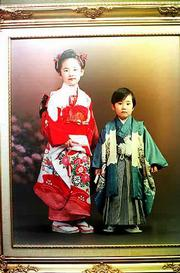 In a studio in Kyoto, businesses offer traditional Japanese photos. You bring your family and they furnish the clothing.