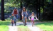 Randy Conway takes a bike ride with her son, Coke III, left, daughter, Jessica, and husband, Coke Jr., in St. Amant, La. Conway is among the first people in this country to test a new artificial disc that offers hope to people who otherwise would need a much more extensive operation to fuse two vertebrae together.