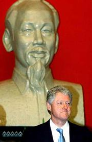 President Clinton stands under a bust of former revolutionary leader Ho Chi Minh during an official welcoming ceremony in the Presidential Palace in Hanoi, Vietnam, Friday, Nov.17, 2000.