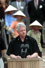 President Clinton addresses officials and workers at an MIA excavation site in Tien Chau, Vietnam, where anthropologists are searching for the remains of Vietnam War fighter pilot Lawrence Evert.