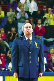 To the applause of the Allen Fieldhouse crowd during halftime of Monday's Kansas University men's basketball game against Boise State, KU Air Force ROTC cadet Todd Craig is honored for rescuing a car accident victim.