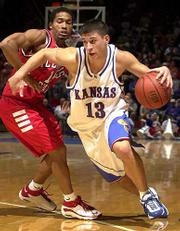 Kansas' Jeff Boschee (13) drives past ISU's Randy Rice. Boschee finished with seven points Thursday.