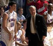 KU coach roy williams was seething when he pulled his starters, including Kirk Hinrich (10), Drew Gooden, second from left, and Kenny Gregory, far right, early against Illinois State. The Jayhawks struggled to an 80-61 victory Thursday night at Allen Fieldhouse.