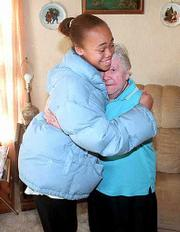 Woodlawn School sixth-grader Shea Clark, 12, left, is credited with saving the life of North Lawrence resident Eunice Tryon, 83. Shea was on her way to school Nov. 20 when she stopped to help Tryon, who had suffered a stroke. The two reunited Monday at Tryon's home.