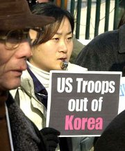 More than 200 South Korean protesters demanded the withdrawal of 37,000 U.S. troops from Korean peninsula, as well as compensation of the alleged No Gun Ri massacre, in which Korean civilians were killed by U.S. troops in July 1950.