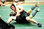 Free State High sophomore wrestler Nick McGovern, top, pins Olathe South's Jeff Caraway. McGovern's pin came in a double-dual Wednesday at Free State.