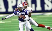 Indianapolis' Jerome Pathon, front, is brought down from behind by Buffalo cornerback Darrell Porter. The play setup the Colts' first field goal in a 44-20 victory over the Bills on Monday in Indianapolis.