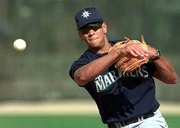 Former Seattle Shortstop Alex Rodriguez signed a $252 million, 10-year pact with the Texas Rangers on Monday.